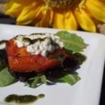 Baked mushroom stuffed with goats cheese drizzled with pesto
