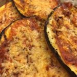 Eggplant with roasted red pepper sauce and melted cheese